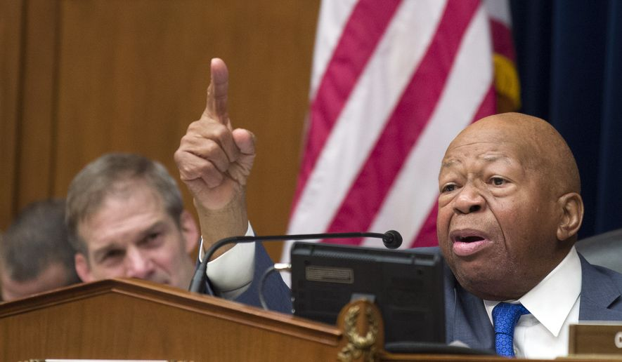House Oversight and Reform Committee Chair Elijah Cummings, D-Md., right, speaks as he gives closing remarks with Rep. Jim Jordan, R-Ohio, the ranking member, at left, as the hearing for Michael Cohen, President Donald Trump's former lawyer, at the House Oversight and Reform Committee concludes, on Capitol Hill, Wednesday, Feb. 27, 2019, in Washington. (AP Photo/Alex Brandon)