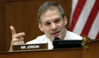 Ranking Member Jim Jordan, R-Ohio, asks questions to Michael Cohen, President Donald Trump's former personal lawyer, during a hearing of the House Oversight and Reform Committee on Capitol Hill in Washington, Wednesday, Feb. 27, 2019. (AP Photo/Pablo Martinez Monsivais)