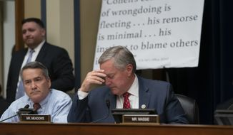 Rep. Mark Meadows, R-N.C., joined at left by Rep. Jody Hice, R-Ga., leads objections to testimony by Michael Cohen, President Donald Trump's former personal lawyer, at the House Oversight and Reform Committee about his behind-the-scenes knowledge of Trump's activities, including possible criminal conduct, on Capitol Hill in Washington, Wednesday, Feb. 27, 2019. (AP Photo/J. Scott Applewhite)