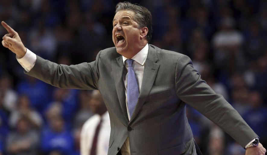 Kentucky coach John Calipari directs his team during the second half of an NCAA college basketball game against Arkansas in Lexington, Ky., Tuesday, Feb. 26, 2019. Kentucky won 70-66. (AP Photo/James Crisp)