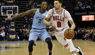 Chicago Bulls guard Zach LaVine (8) drives against Memphis Grizzlies guard Delon Wright (2) in the second half of an NBA basketball game Wednesday, Feb. 27, 2019, in Memphis, Tenn. (AP Photo/Brandon Dill)