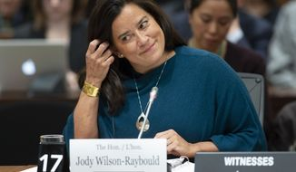 Jody Wilson Raybould adjusts her earpiece as she waits to appear in front of the Justice committee in Ottawa, Wednesday February 27, 2019. 7, 2019. Wilson Raybould is testifying she experienced a consistent and sustained effort by many people in Prime Minister Justin Trudeau's government to inappropriately interfere in the prosecution of a major Canadian engineering company (Adrian Wyld/The Canadian Press via AP)