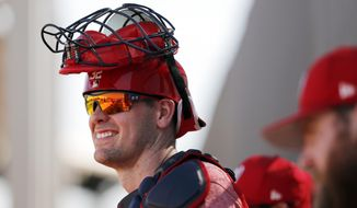 FILE - In this Feb. 17, 2018, file photo, Washington Nationals catcher Matt Wieters watches during spring training baseball practice in West Palm Beach, Fla. Wieters has agreed to a minor league contract with the St. Louis Cardinals. If added to the 40-man roster, the 32-year-old would get a one-year contract calling for a $1.5 million salary while in the major leagues. Wieters spent the past two seasons with Washington. (AP Photo/Jeff Roberson, File)