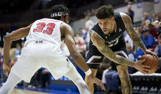 Cincinnati guard Jarron Cumberland (34) brings the ball up court against SMU's Jimmy Whitt Jr. (33) during the first half of an NCAA college basketball game at Moody Coliseum, Wednesday, Feb. 27, 2019, in Dallas. (AP Photo/Cooper Neill)