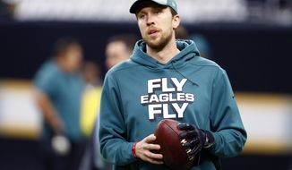FILE - In this Jan. 13, 2019, file photo, Philadelphia Eagles quarterback Nick Foles warms up before an NFL divisional playoff football game against the New Orleans Saints in New Orleans. Eagles general manager Howie Roseman said Wednesday, Feb. 27,2 019, that the team will not use its franchise tag on Foles and instead will let him become a free agent. (AP Photo/Butch Dill, File)