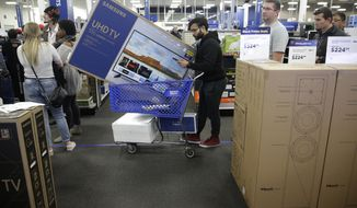FILE- In this Nov. 22, 2018, file photo people wait in line to buy televisions as they shop during an early Black Friday sale at a Best Buy store on Thanksgiving Day in Overland Park, Kan. Best Buy Co., Inc. reports financial results Wednesday, Feb. 27, 2019. (AP Photo/Charlie Riedel, FIle)