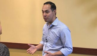 Democratic presidential candidate Julian Castro responds to a reporter before a speech at Boise State University on Tuesday, Feb. 26, 2019, in Boise, Idaho. The 44-year-old former housing secretary in the Obama administration later told about 600 people that if the United States is going to be the most prosperous nation in the world, then everyone has to prosper. (AP Photo/Keith Ridler)