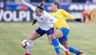 England's Lucy Bronze, left, goes after the ball while keeping Brazil's Beatriz, right, away during the first half of She Believes Cup soccer match, Wednesday, Feb. 27, 2019, in Chester, Pa. (AP Photo/Chris Szagola)