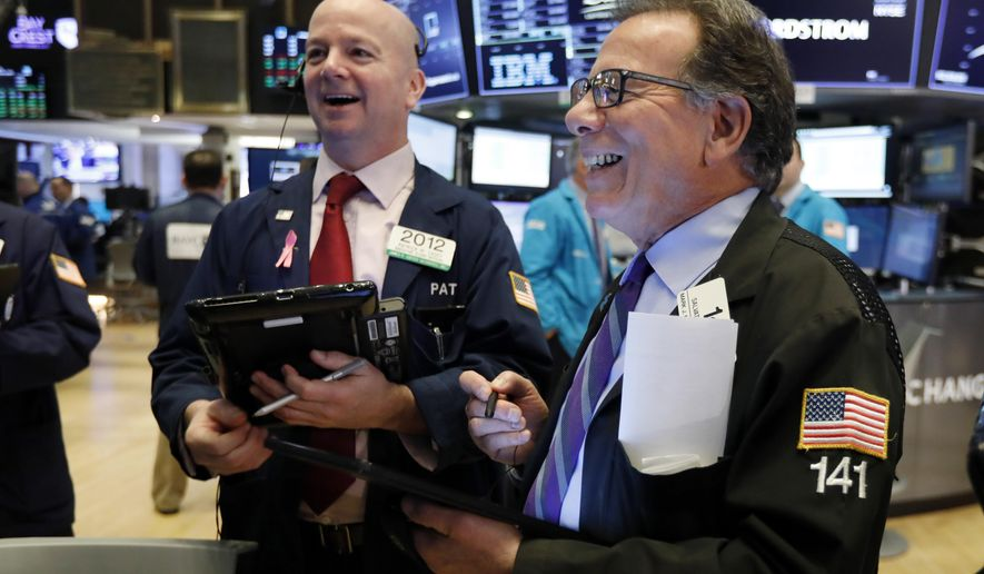 FILE- In this Feb. 15, 2019, file photo traders Patrick Casey, left, and Sal Suarino work on the floor of the New York Stock Exchange. The U.S. stock market opens at 9:30 a.m. EST on Wednesday, Feb. 27. (AP Photo/Richard Drew, File)