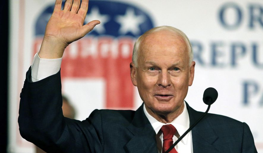 FILE - In this Nov. 8, 2016, file photo, Dennis Richardson, the Oregon Republican Secretary of state candidate, waves to the crowd during an election night event in Salem, Ore. Richardson, the highest-ranking Republican in Oregon state government, died at home Tuesday night, Feb. 26, 2019, surrounded by family and friends after a battle with brain cancer. He was 69. (AP Photo/Timothy J. Gonzalez, File)