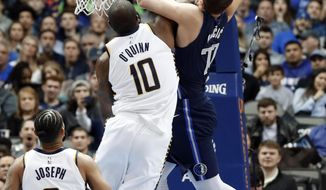 Dallas Mavericks forward Luka Doncic, right, is fouled going to the basket for a shot by Indiana Pacers center Kyle O'Quinn, left, as Cory Joseph (6) watches in the first half of an NBA basketball game in Dallas, Wednesday, Feb. 27, 2019. O'Quinn was issued a flagrant foul on the play. (AP Photo/Tony Gutierrez)