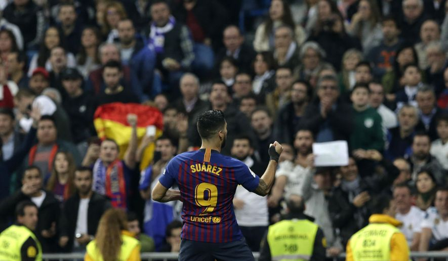 Barcelona forward Luis Suarez celebrates after scoring his side's opening goal during the Copa del Rey semifinal second leg soccer match between Real Madrid and FC Barcelona at the Bernabeu stadium in Madrid, Spain, Wednesday Feb. 27, 2019. (AP Photo/Andrea Comas)