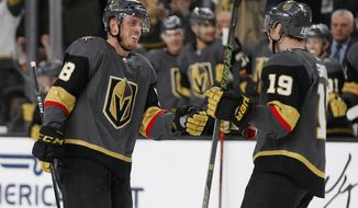 Vegas Golden Knights right wing Reilly Smith (19) celebrates after defenseman Nate Schmidt, left, scored against the Dallas Stars during the third period of an NHL hockey game Tuesday, Feb. 26, 2019, in Las Vegas. (AP Photo/John Locher)