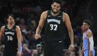 Minnesota Timberwolves center Karl-Anthony Towns winces after being fouled and missing a three point shot during the first half of an NBA basketball against the Atlanta Hawks, Wednesday, Feb. 27, 2019, in Atlanta. (AP Photo/John Amis)