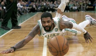 Boston Celtics guard Kyrie Irving dives after a loose ball during the second half of the team's NBA basketball game against the Portland Trail Blazers, Wednesday, Feb. 27, 2019, in Boston. (AP Photo/Mary Schwalm)
