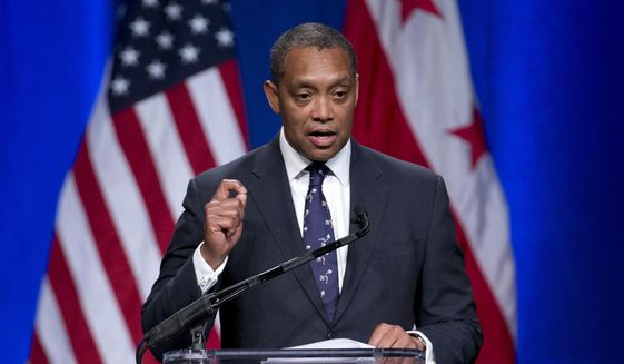 In this Jan. 2, 2015, file photo, Attorney General of the District of Columbia Karl Racine speaks during the 2015 District of Columbia Inauguration ceremony at the Convention Center in Washington. (AP Photo/Carolyn Kaster) ** FILE **