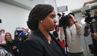 Rep. Ayanna Pressley, D-Mass., walks past members of the media during a lunch break in the hearing of Michael Cohen, President Donald Trump's former lawyer, before the House Oversight and Reform Committee on Capitol Hill in Washington, Wednesday, Feb. 27, 2019. (AP Photo/Pablo Martinez Monsivais)