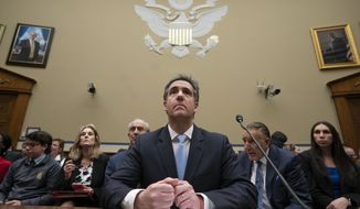 Michael Cohen, President Donald Trump's former personal lawyer, listens as he finishes a day of testimony to the House Oversight and Reform Committee, on Capitol Hill in Washington, Wednesday, Feb. 27, 2019. (AP Photo/J. Scott Applewhite)