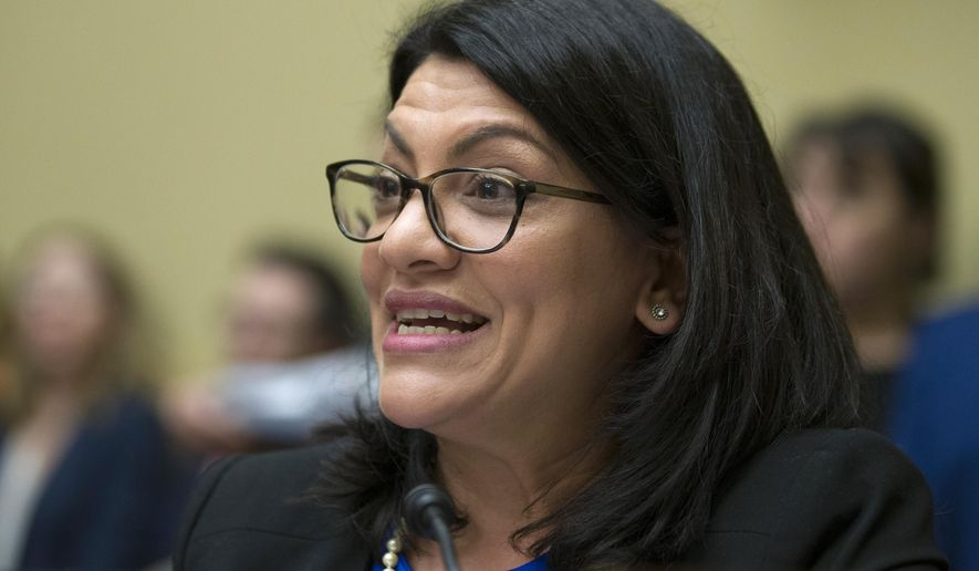 Rep. Rashida Tlaib, D-Mich., questions Michael Cohen, President Donald Trump's former lawyer, as he testifies before the House Oversight and Reform Committee, on Capitol Hill, Wednesday, Feb. 27, 2019, in Washington. (AP Photo/Alex Brandon) ** FILE **