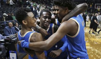 FILE - In this Jan. 10, 2019, file photo, UCLA's Jaylen Hands, left, Prince Ali, Kris Wilkes and Chris Smith celebrate after UCLA defeated Oregon in an NCAA college basketball game in Eugene, Ore. After many starts and stops, the Bruins appear to be on the upswing behind sophomore guard Hands'leadership, along with sophomore Wilkes and freshman Jules Bernard. (AP Photo/Chris Pietsch, File)
