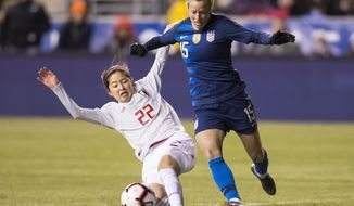 United States' Megan Rapinoe, right, tries to get around Japan's Risa Shimizu, left, with the ball during the first half of SheBelieves Cup soccer match, Wednesday, Feb. 27, 2019, in Chester, Pa. (AP Photo/Chris Szagola)