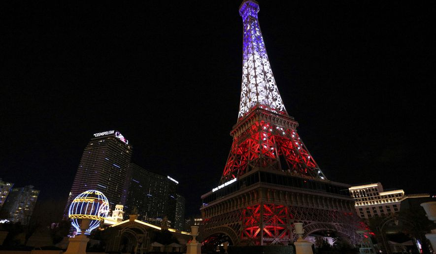 The Paris Las Vegas debuts a new Eiffel Tower light show on the Strip in Las Vegas, Wednesday, Feb. 27, 2019. The landmark at the Paris Las Vegas casino-resort on Wednesday unveiled the new show featuring synchronized twinkling and colored lights.(Caroline Brehman/Las Vegas Review-Journal via AP)