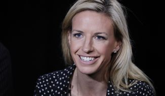FILE - In this May 30, 2018, file photo, Aly Wagner talks during an interview in New York. JP Dellacamera and former U.S. midfielder Aly Wagner will be Fox's lead broadcast team for the Women's World Cup in France. The announcement comes 100 days before the tournament opens June 7 with a matchup of France and South Korea. Fox said Wednesday, Feb. 27, 2019, that 22 matches will be broadcast on the main Fox network, 27 on FS1 and three on FS2. (AP Photo/Mark Lennihan, File)