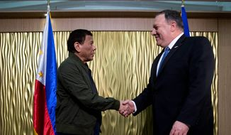 "Secretary of State Mike Pompeo (right) met with Philippine President Rodrigo Duterte on Thursday for private talks on a range of subjects, including ""ways to improve cooperation on regional security and counterterrorism,"" according to the State Department. (ASSOCIATED PRESS)"