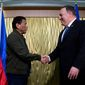 """Secretary of State Mike Pompeo (right) met with Philippine President Rodrigo Duterte on Thursday for private talks on a range of subjects, including """"ways to improve cooperation on regional security and counterterrorism,"""" according to the State Department. (ASSOCIATED PRESS)"""