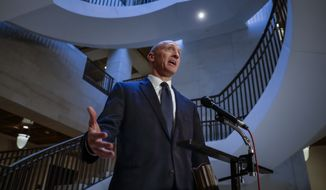 Carter Page, a foreign policy adviser to Donald Trump's 2016 presidential campaign, speaks with reporters following a day of questions from the House Intelligence Committee, on Capitol Hill in Washington, Thursday, Nov. 2, 2017. (AP Photo/J. Scott Applewhite)