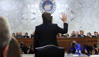 President Donald Trump's Supreme Court nominee Brett Kavanaugh is sworn in before the Senate Judiciary Committee on Capitol Hill in Washington, Tuesday, Sept. 4, 2018, to begin his testimony in his confirmation hearing to replace retired Justice Anthony Kennedy. (AP Photo/Manuel Balce Ceneta)