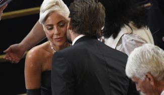 """Bradley Cooper, right, congratulates Lady Gaga, winner of the award for best original song for """"Shallow"""" from """"A Star Is Born"""" at the Oscars on Sunday, Feb. 24, 2019, at the Dolby Theatre in Los Angeles. (Photo by Chris Pizzello/Invision/AP)"""