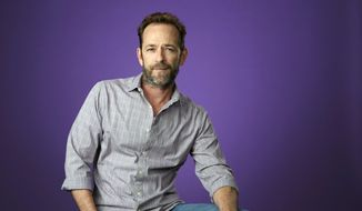 """In this Aug. 6, 2018, file photo, Luke Perry, a cast member in the CW series """"Riverdale,"""" poses for a portrait during the 2018 Television Critics Association Summer Press Tour in Beverly Hills, Calif. (Photo by Chris Pizzello/Invision/AP, File)"""