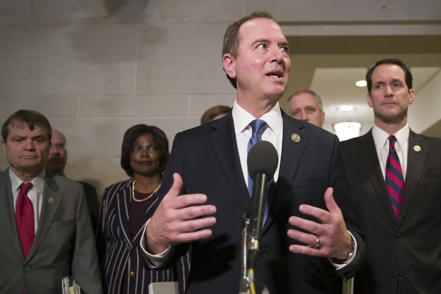 House Intelligence Committee Chairman Adam Schiff, of Calif., accompanied by fellow Democratic members of the committee, talks with the media after hearing Michael Cohen, President Donald Trump's former lawyer, testify before a closed-door hearing of the House Intelligence Committee, on Capitol Hill, Thursday, Feb. 28, 2019, in Washington. (AP Photo/Alex Brandon)