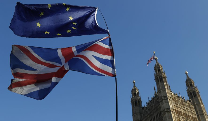 The flag of the European Union and the British national flags are flown on poles during a demonstration by remain in the EU outside spporters the Palace of Westminster in London, Wednesday, Feb. 27, 2019. British Prime Minister Theresa May says she will give British lawmakers a choice of approving her divorce agreement, leaving the EU March 29 without a deal or asking to delay Brexit by up to three months. (AP Photo/Alastair Grant)
