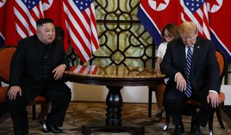 President Donald Trump meets North Korean leader Kim Jong Un, Thursday, Feb. 28, 2019, in Hanoi. (AP Photo/ Evan Vucci)