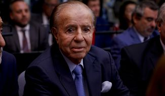 Former Argentine President Carlos Menem sits at a court house in Buenos Aires, Argentina, Thursday, Feb. 28, 2019. The court is expected to give its verdict on the trial against Menem, several former officials, a former federal judge and two former prosecutors, accused of hampering the investigation of the attack on a Jewish center in Buenos Aires in 1994. (AP Photo/Natacha Pisarenko)