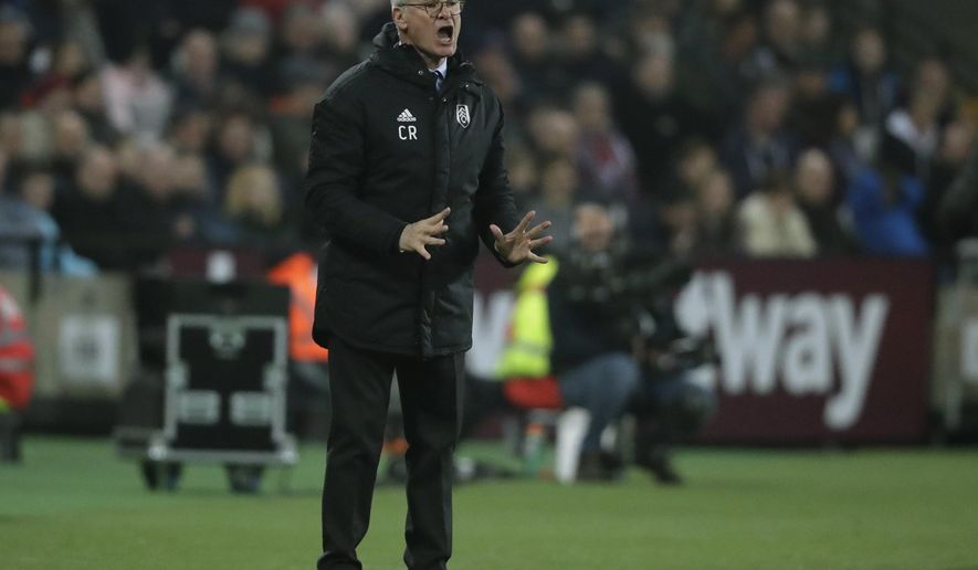 Fulham manager Claudio Ranieri gestures during the English Premier League soccer match between West Ham and Fulham at the London Stadium in London, Friday, Feb. 22, 2019. (AP Photo/Matt Dunham)