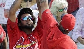 St. Louis Cardinals' Jose Martinez, left, and Yadier Molina celebrate following a three-run home run by teammate Ramon Urias during the fifth inning of an exhibition spring training baseball game against the Miami Marlins Saturday, Feb. 23, 2019, in Jupiter, Fla. (AP Photo/Jeff Roberson)