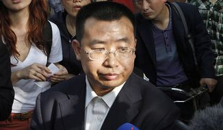 FILE - In this May 2, 2012, file photo, human rights activist Jiang Tianyong speaks to journalists outside a hospital after his failed attempt to see blind Chinese activist Chen Guangcheng who is believed to be seeking treatment in Beijing, China. The prominent Chinese human rights lawyer who defended politically-sensitive clients like blind legal activist Chen Guangcheng and followers of the outlawed Falun Gong spiritual group, has disappeared on the day he was scheduled to be released from prison after completing his two-year jail sentence Thursday, Feb. 28, 2019. (AP Photo/Ng Han Guan, File)