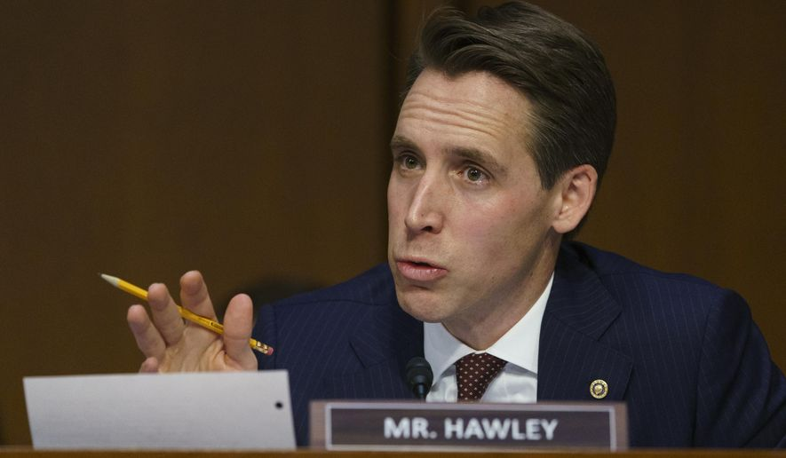 FILE - IN this Jan 15, 2019 file photo, Senate Judiciary Committee committee member Sen. Josh Hawley, R-Mo., questions Attorney General nominee William Barr during a Senate Judiciary Committee on Capitol Hill in Washington. Hawley is facing conservative backlash after raising concerns with President Donald Trump's nominee to a high-profile appeals court. The Judicial Crisis Network on Monday announced plans to spend $500,000 on Missouri ads to sway Hawley to support D.C.-area U.S. Circuit Court of Appeals nominee Neomi Rao. Hawley on Monday told KFTK 97.1 FM Newstalk's Marc Cox that Rao doesn't have a strong record on abortion. (AP Photo/Carolyn Kaster, File)