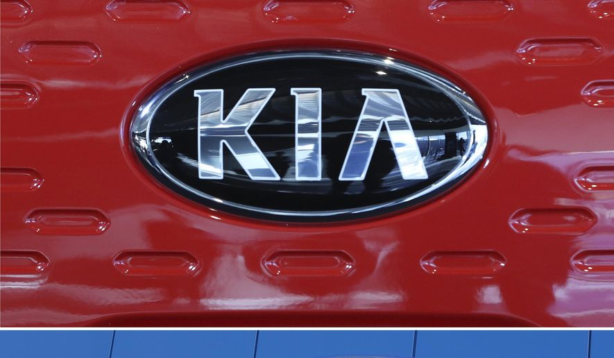 This combination of file photos shows the logo of Kia Motors during an unveiling ceremony on Dec. 13, 2017, in Seoul, South Korea, top, and Hyundai logo on the side of a showroom on April 15, 2018, in the south Denver suburb of Littleton, Colo., bottom. Hyundai and Kia are recalling more than a half million vehicles in the U.S. because of new problems that can lead to engine fires. Documents posted Thursday, Feb. 28, 2019, by the government show the Korean automakers are adding three recalls after reports of fires across the country. (AP Photo, File)