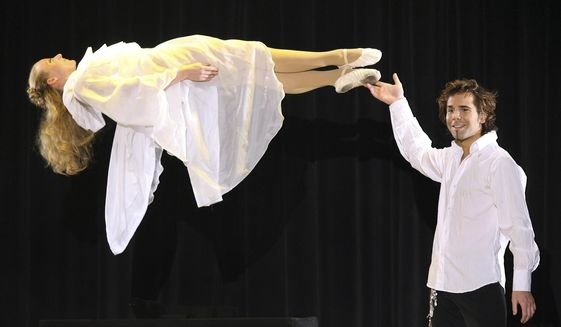 FILE - In this March 17, 2007, file photo, magician Jan Rouven Fuechtener presents the Floating Virgin during the dress rehearsal of a German TV show in Riesa, eastern Germany. Fuechtener, a former Las Vegas Strip illusion show headliner, is expected to face at least 24 years in prison following a failed effort to withdraw his guilty plea in a federal child pornography case. Fuechtener is a German citizen who performed under the name Jan Rouven at the Tropicana hotel-casino. His show closed following his arrest in March 2016. (AP Photo/Eckehard Schulz, File)