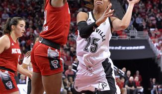 Louisville guard Asia Durr (25) attempts an off-balance shot over North Carolina State forward DD Rogers (21) during the second half of an NCAA college basketball game in Louisville, Ky., Thursday, Feb. 28, 2019. Louisville won 92-62 (AP Photo/Timothy D. Easley)
