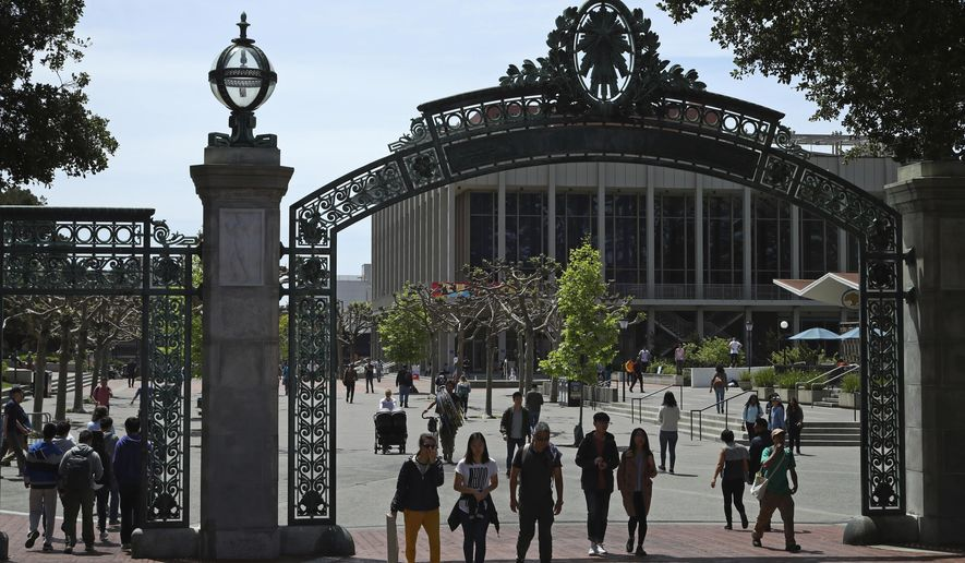 FILE - In this May 10, 2018, file photo, students walk past Sather Gate on the University of California at Berkeley campus in Berkeley, Calif. Choosing a college based on price can save you from overwhelming student debt, give your parents a break and increase the likelihood of a return on investment in your education.  (AP Photo/Ben Margot, file)