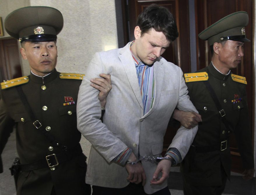 """In this March 16, 2016, file photo, American student Otto Warmbier, center, is escorted at the Supreme Court in Pyongyang, North Korea. In remarks at a Sept. 20, 2019, news conference, President Trump blamed his predecessor's administration for not having """"moved faster"""" to secure Warmbier's release. (AP Photo/Jon Chol Jin, File) **FILE**"""
