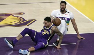 New Orleans Pelicans' Anthony Davis, right, collides with Los Angeles Lakers' Kyle Kuzma during the first half of an NBA basketball game Wednesday, Feb. 27, 2019, in Los Angeles. (AP Photo/Marcio Jose Sanchez)