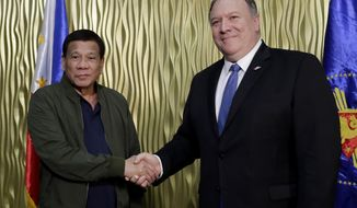 Philippine President Rodrigo Duterte, left, greets U.S. State Secretary Mike Pompeo upon arrival at Villamor Air Base in suburban Pasay city southeast of Manila, Philippines, Thursday, Feb. 28, 2019.  Pompeo, who joined U.S. President Donald Trump in the second summit with North Korean leader Kim Jong-un in Vietnam, is here for talks on the two countries' relations as well as the mutual defense treaty. (AP Photo/Bullit Marquez, POOL)