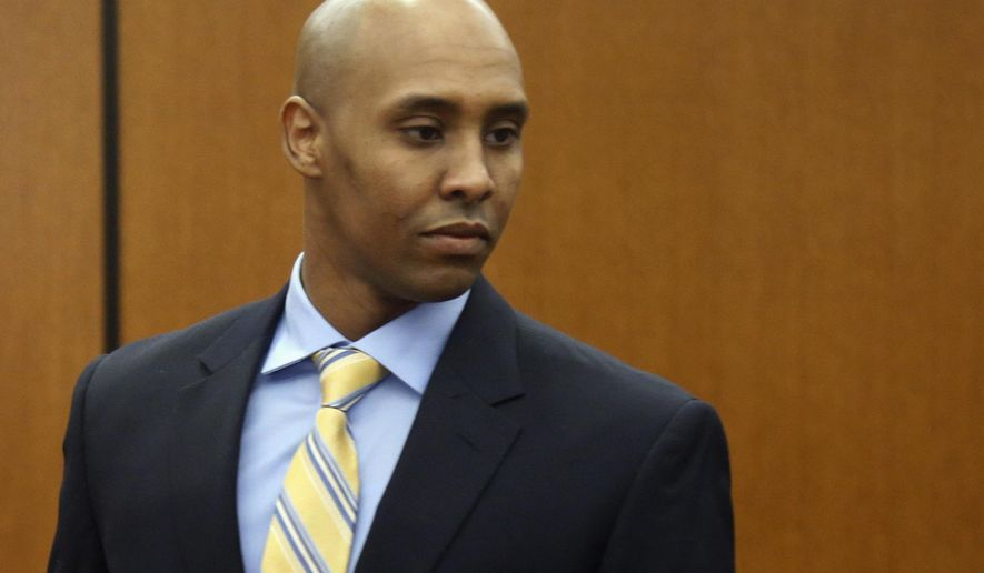 FILE - In this May 8, 2018, file photo, former Minneapolis police officer Mohamed Noor arrives at the Hennepin County Government Center for a hearing in Minneapolis. The former Minneapolis police officer charged in the 2017 shooting death of an Australian woman is scheduled to appear in court as attorneys for both sides argue several issues before trial. Prosecutors have charged Noor with second-degree intentional murder, third-degree murder and manslaughter in the death of Justine Ruszczyk Damond, who was shot after she called 911 to report a possible assault. Noor hasn't entered a plea, but court documents indicate he'll plead not guilty. (AP Photo/Jim Mone, File)
