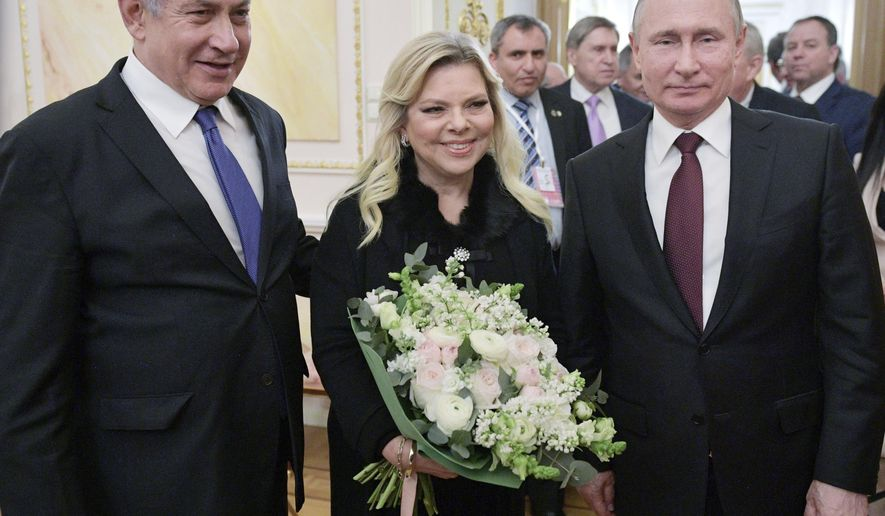 Russian President Vladimir Putin, right, Israeli Prime Minister Benjamin Netanyahu, and his wife Sara pose for a photo after talks in the Kremlin in Moscow, Russia, Wednesday, Feb. 27, 2019. Israel's prime minister vowed to prevent Iran from securing a lasting presence in Syria as he visited Moscow Wednesday for talks focusing on regional security. (Alexei Druzhinin, Sputnik, Kremlin Pool Photo via AP)